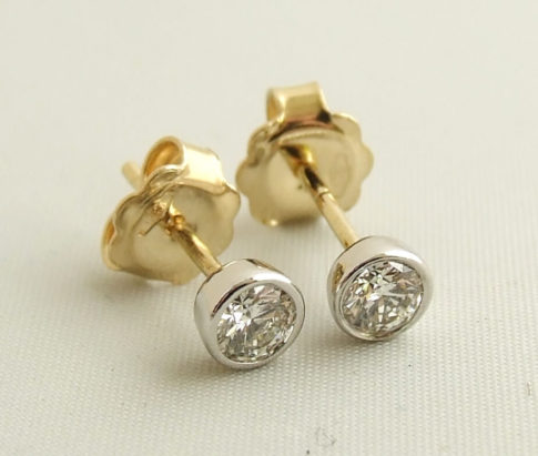 Gouden bicolor diamanten oorstekers