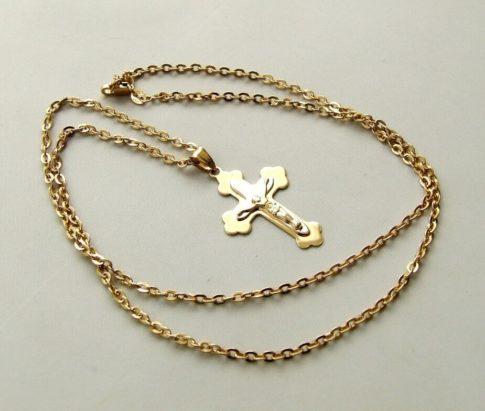 Gouden collier met bicolor kruis
