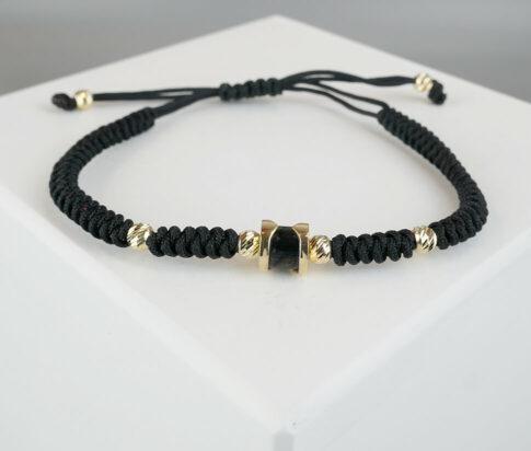 Christian armband met goud en onyx