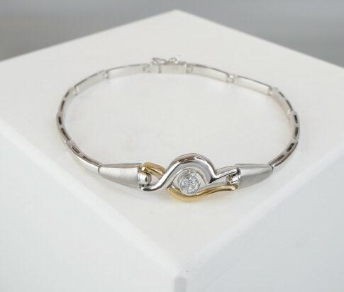 Christian bicolor goud armband met zirkonia